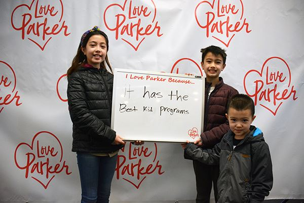 Kids with Love Parker sign